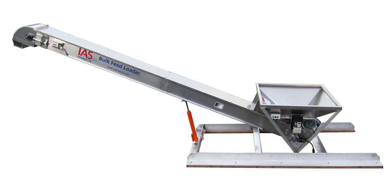 Bulk feed loader conveyor with feed hopper